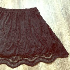 Black lacey material skirt